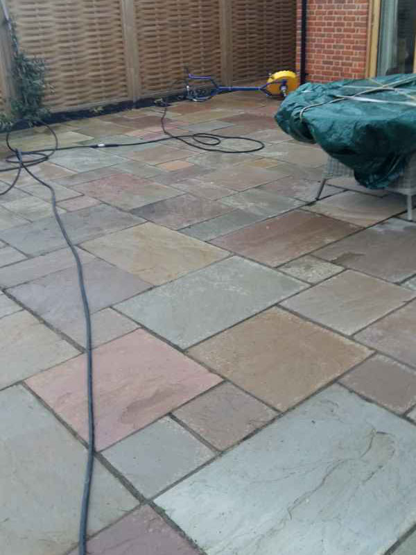 Patio before soft washing cleaning